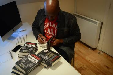Kevin Shird signing books